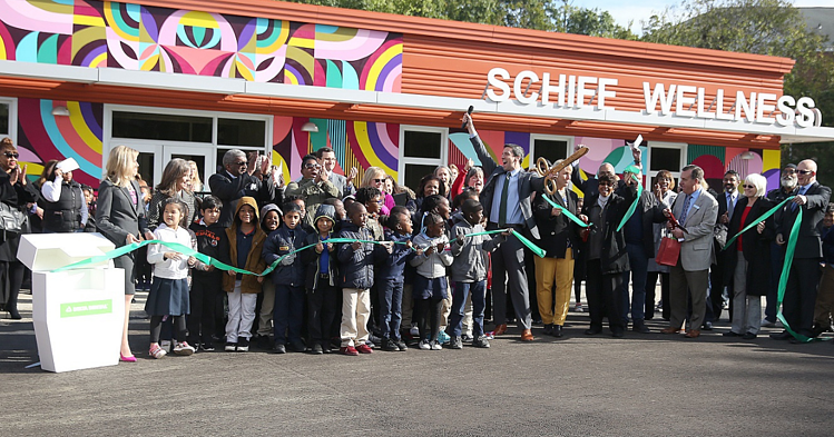 A group of children, teachers, and providers celebrate the opening of a school-based dental center at the Academy of World Languages, part of the Cincinnati Public School district.